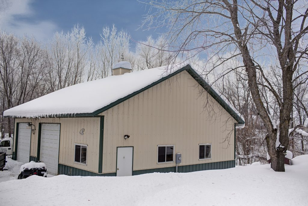 pole shed in winter for sale by the derrick monroe group